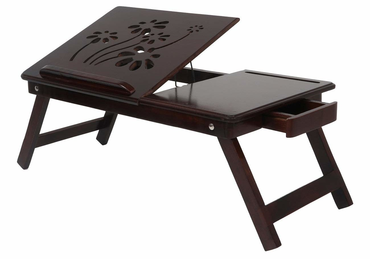 A foldable laptop table in walnut brown.
