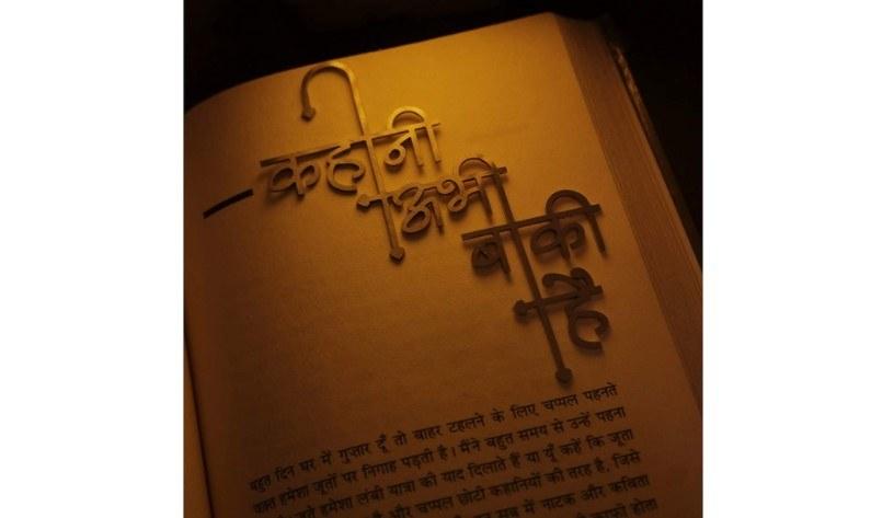 "A bookmark that says ""Kahaani Abhi Baaki Hai"" in Hindi inside a book."