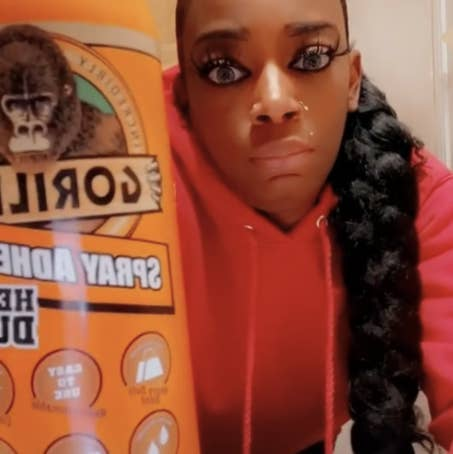 Tessica Brown holds up a bottle of Gorilla Glue spray in a still from the viral video