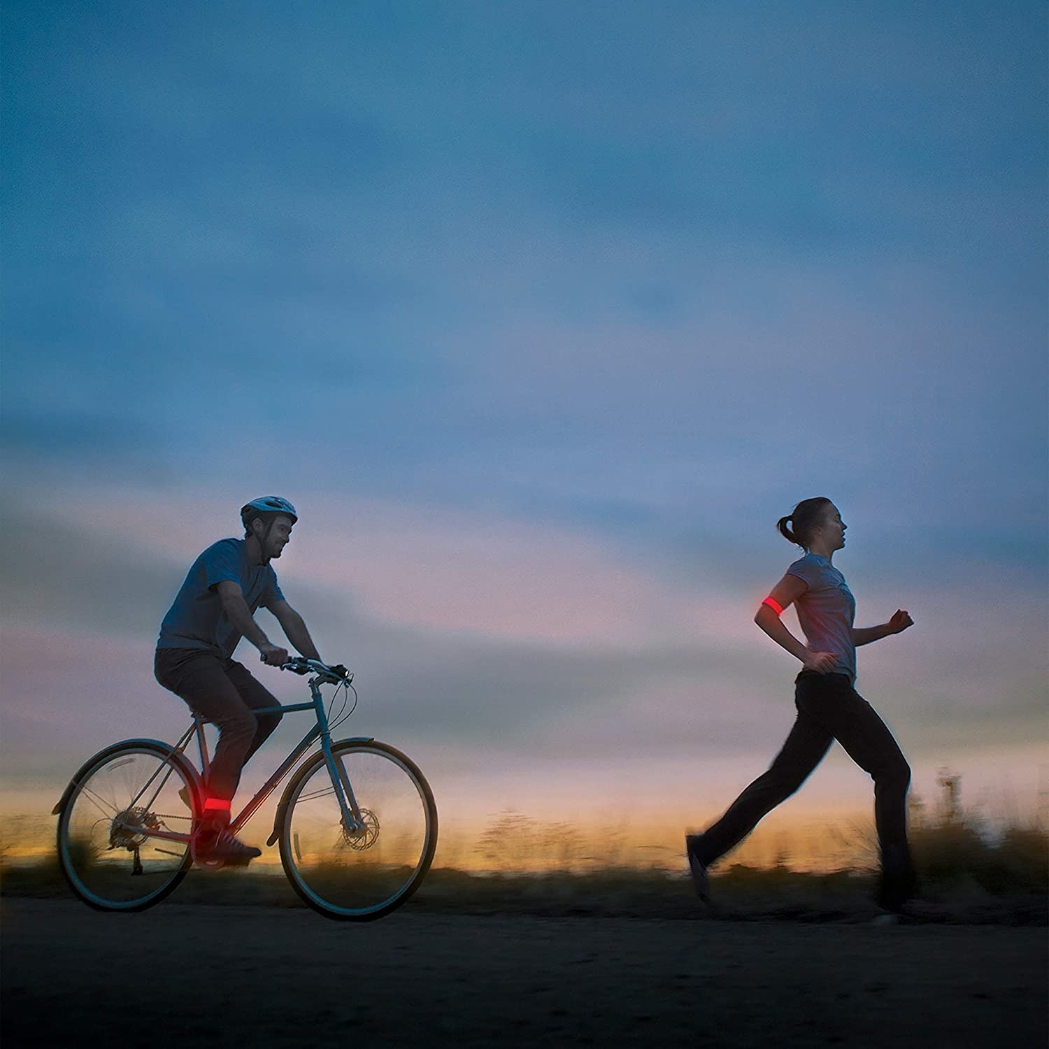 person on a bike and person running both with the strap on