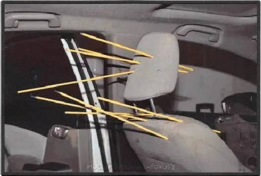 Sticks lodged in the driver's seat of a car to show bullet trajectory