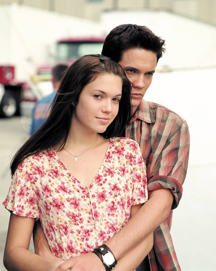 West standing behind Moore with his hands around her body in A Walk to Remember