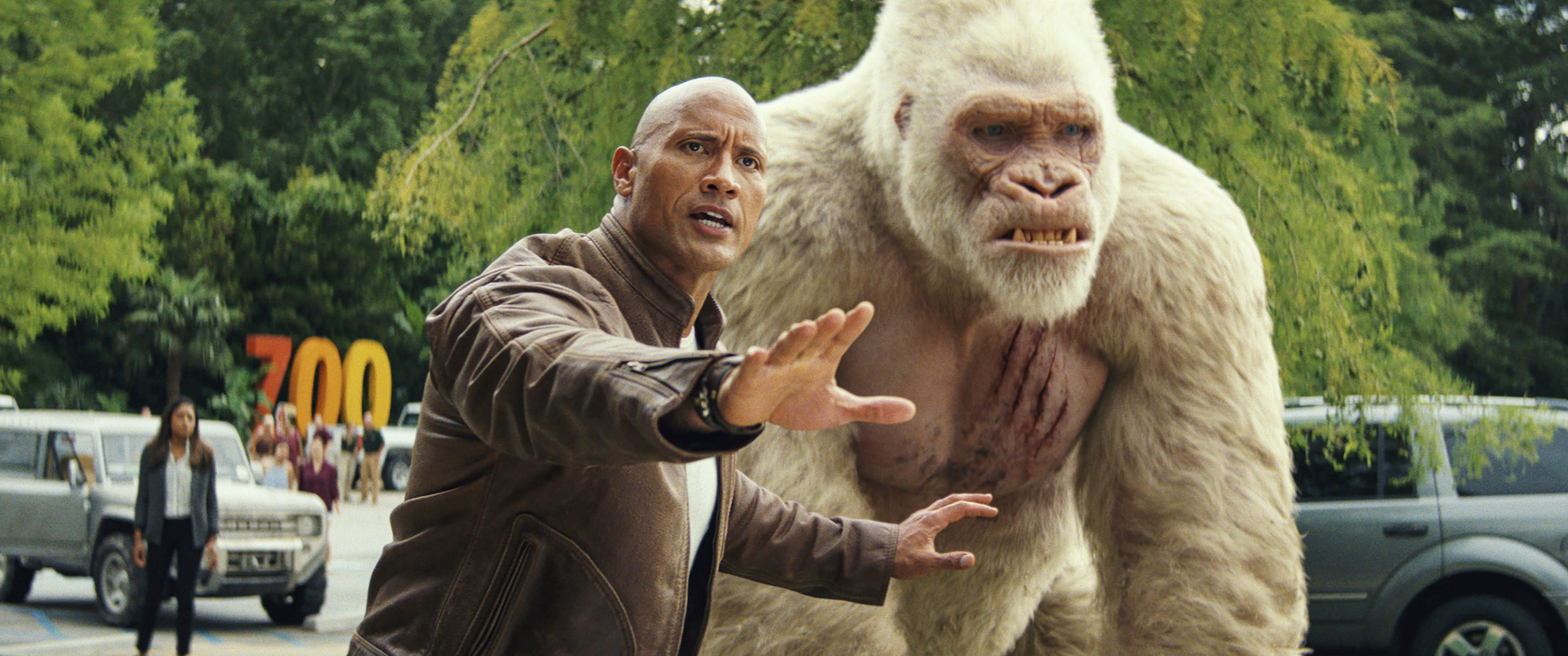 Dwayne Johnson with his white gorilla sidekick, George