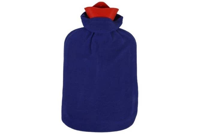 A red hot water bag with a blue cover.