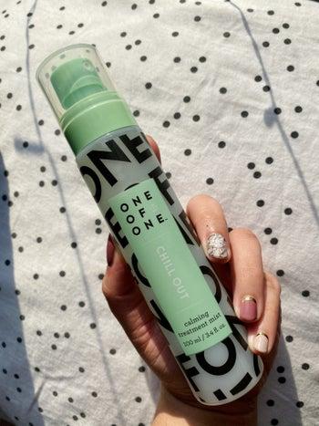 buzzfeed editor holding the spray bottle