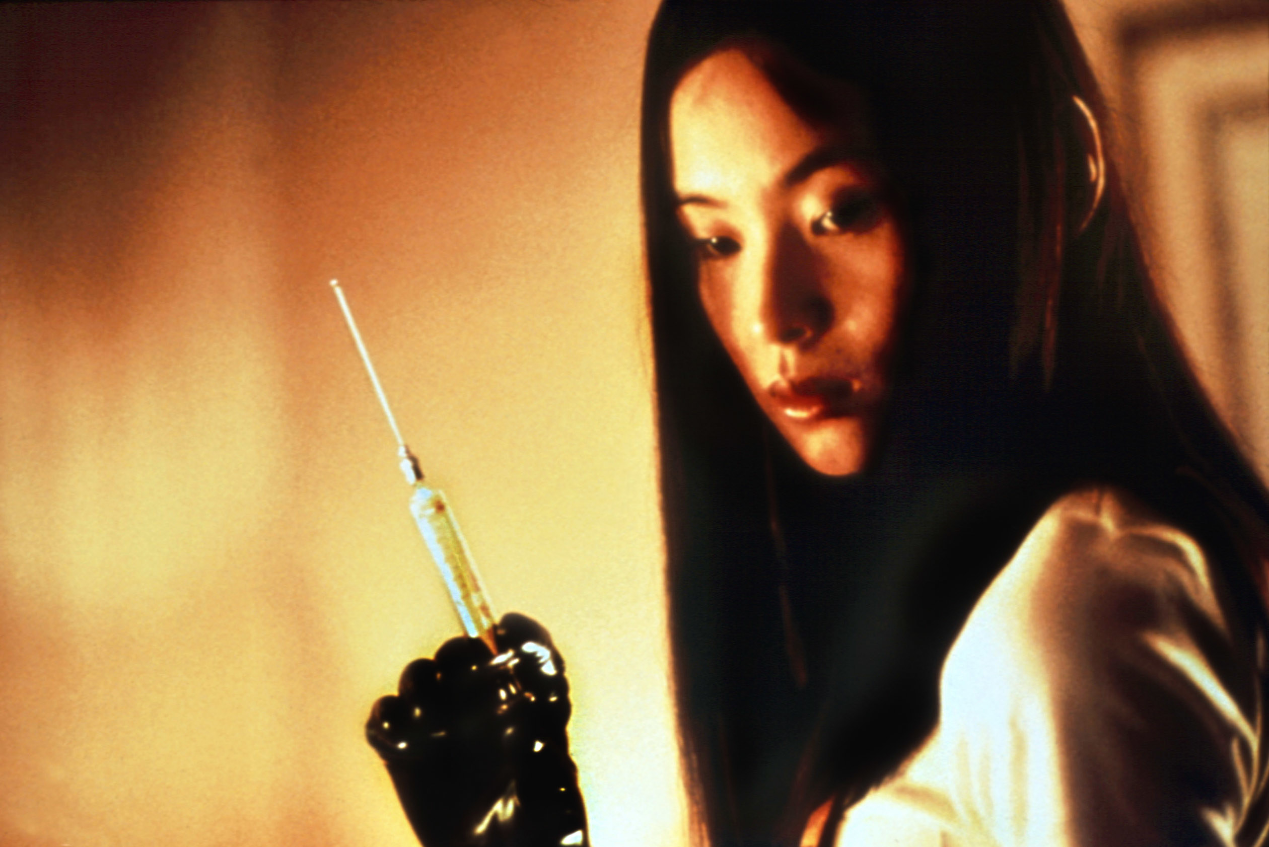 a woman holding an extra long needle