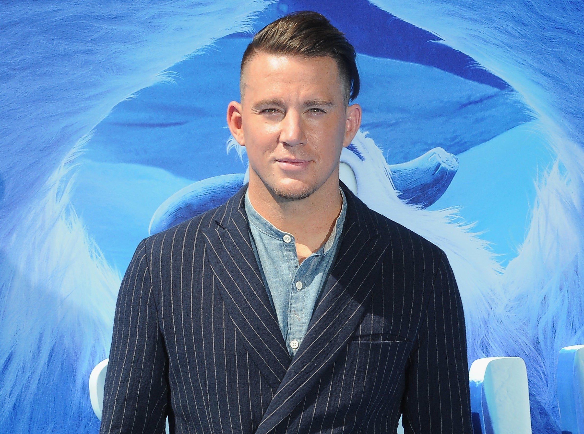 Channing wears a pinstripe suit to an event