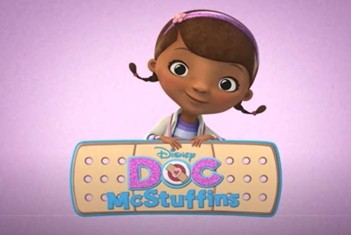 doc mcstuffins sits behind an animated band-aid, smiling