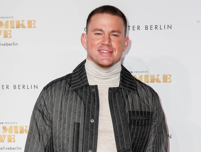 Channing wears a striped jacket and grey turtleneck to an event