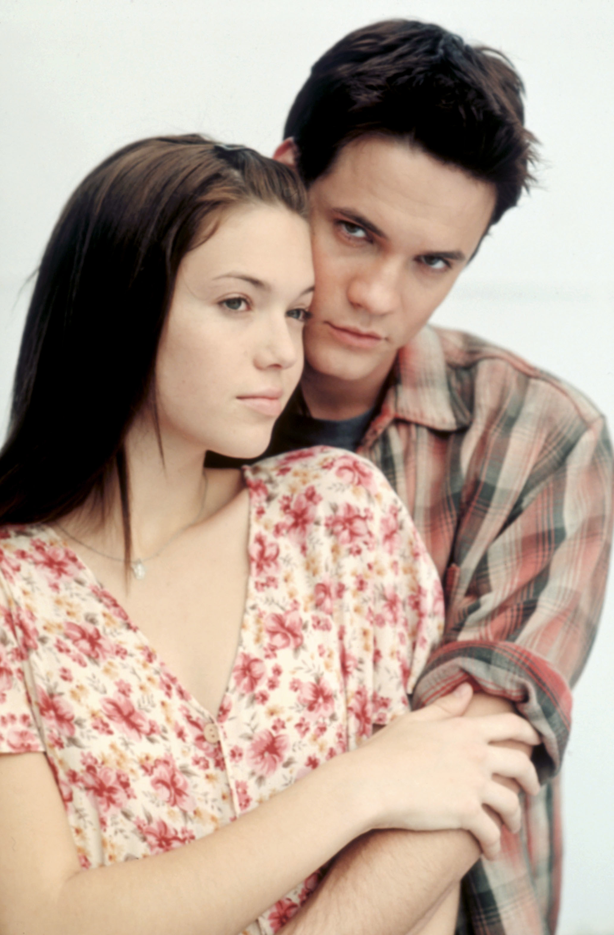 West with his arms wrapped around Moore in A Walk to Remember