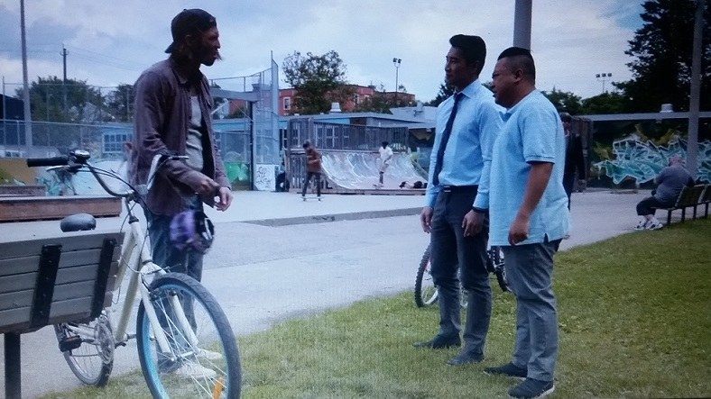 Jung and Kimchee confront the guy with Shannon's bike who is standing next to it and holding Shannon's purple helmet in his hand