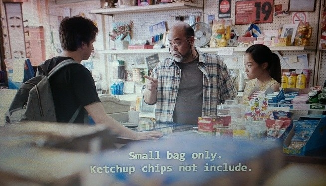 In the Kim's Convenience store, Appa tells Gerald who is across from him that he can have a small bag of chips but not ketchup chips. Janet is standing to the right of Appa