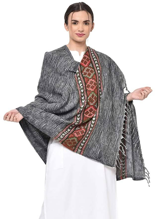A woman wearing a grey shawl with a deep red border.