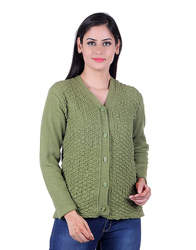 Woman wearing a buttoned up green knit sweater.