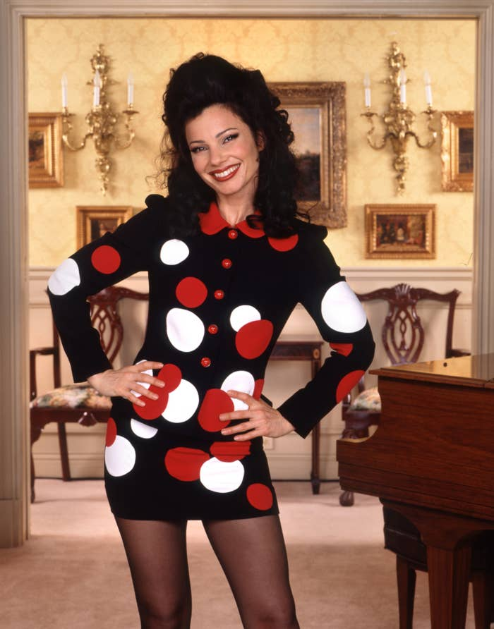 """Fran Drescher poses in a polka-dotted dress on """"The Nanny"""" set"""