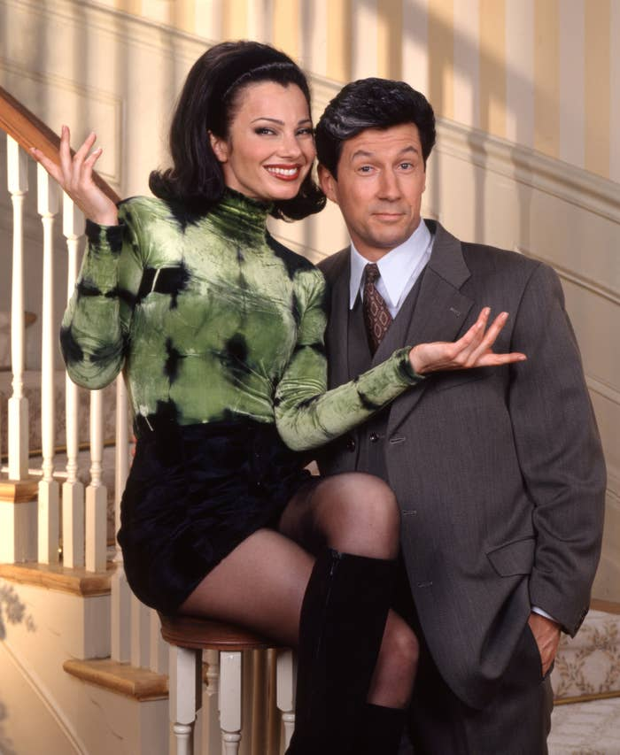 """Fran Drescher and Charles Shaughnessy pose on """"The Nanny"""" set"""