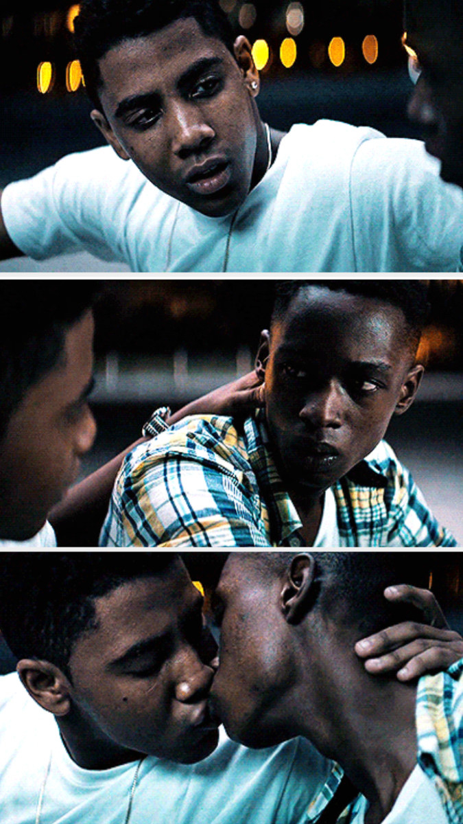 Chiron and Kevin kissing on the sidewalk