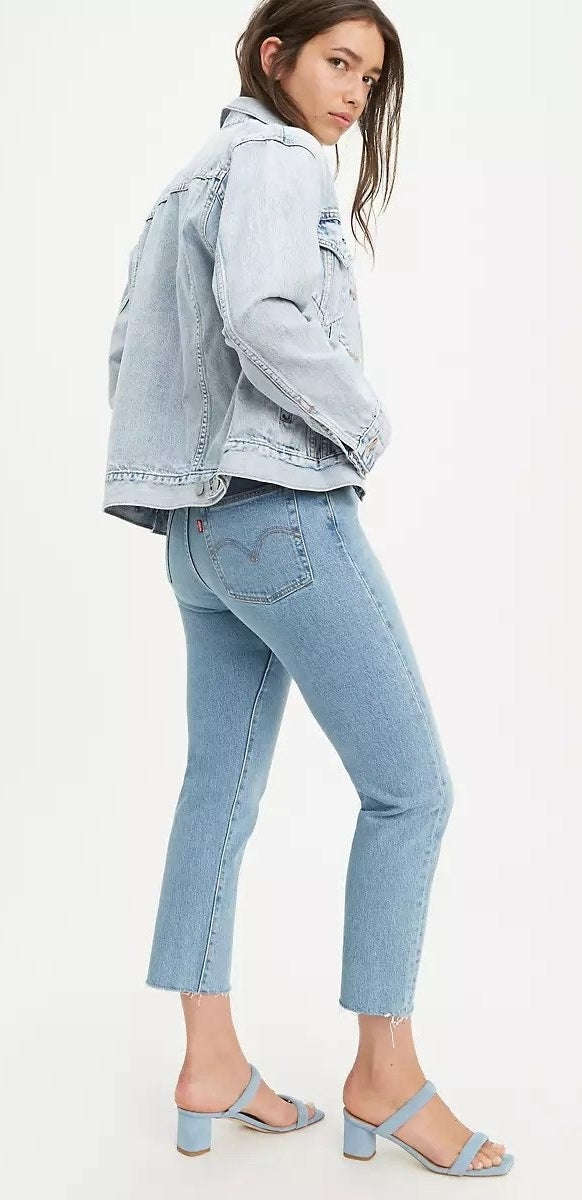 model in light blue Wedgie Fit jeans and matching denim jacket