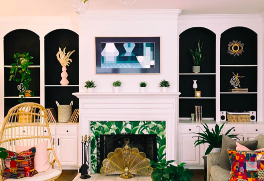 Reviewer's living room with the television showing a modern, geometric painting that matches their decor