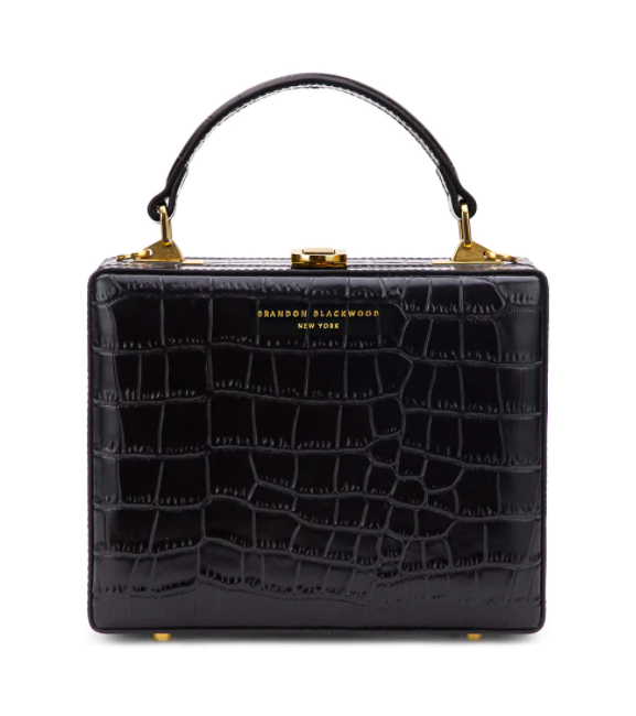 square faux croc skin bag in black with a black handle and gold hardware