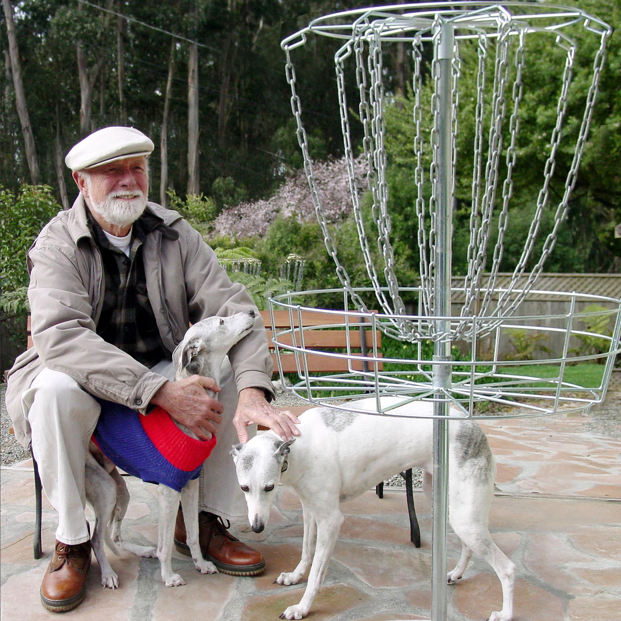 Ed Headrick posing with his dogs