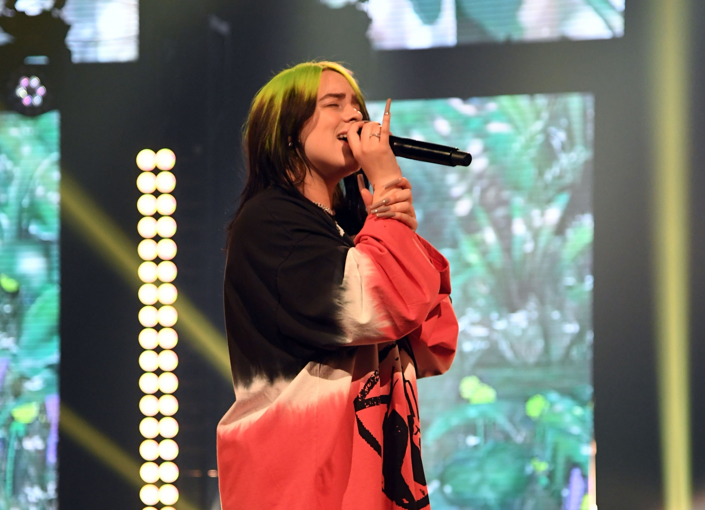Billie Eilish sings onstage