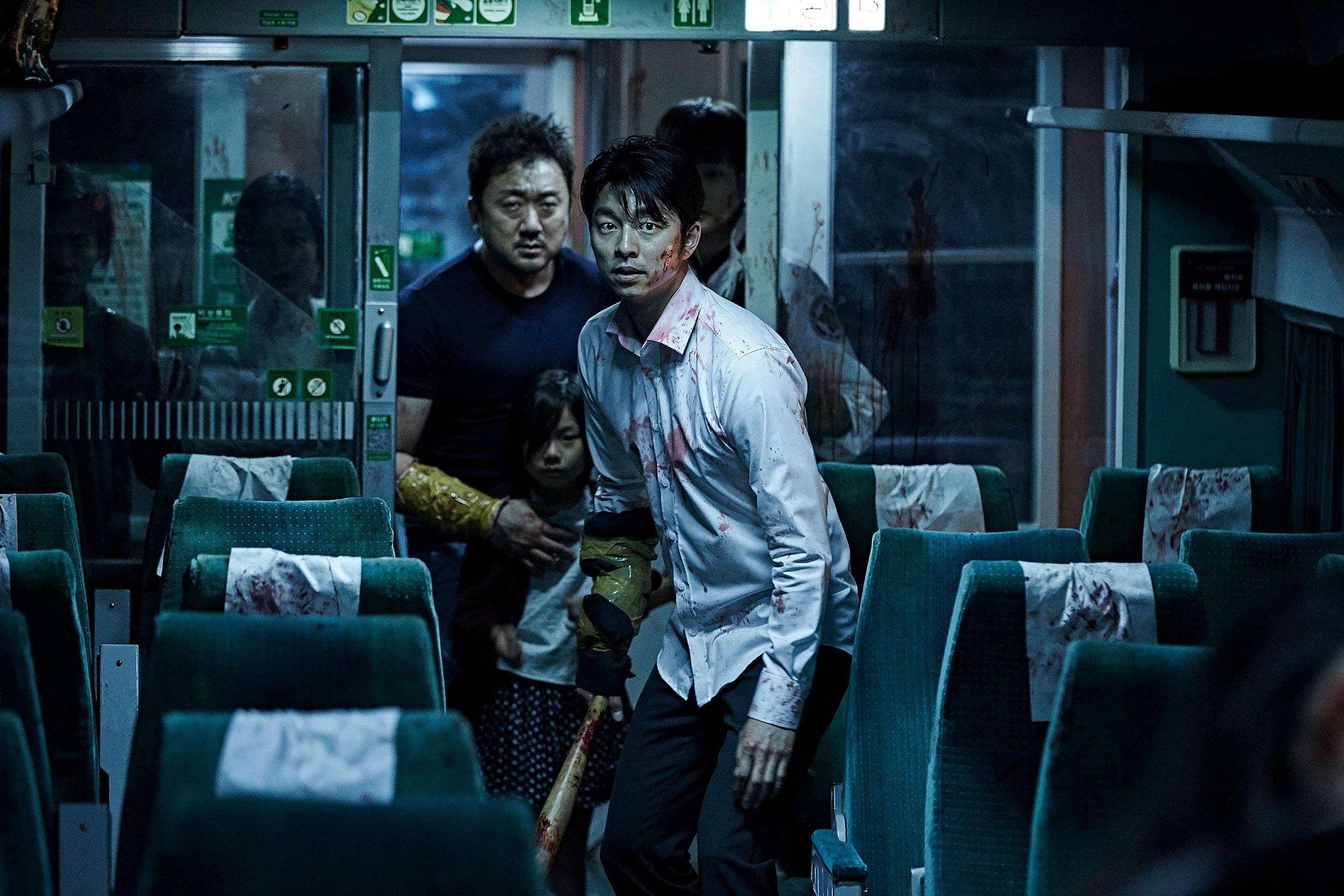 Ma Dong-Seok, Kim Soo-Ahn, and Gong Yoo make their way through a train