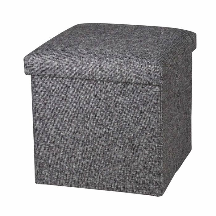 A grey storage ottoman