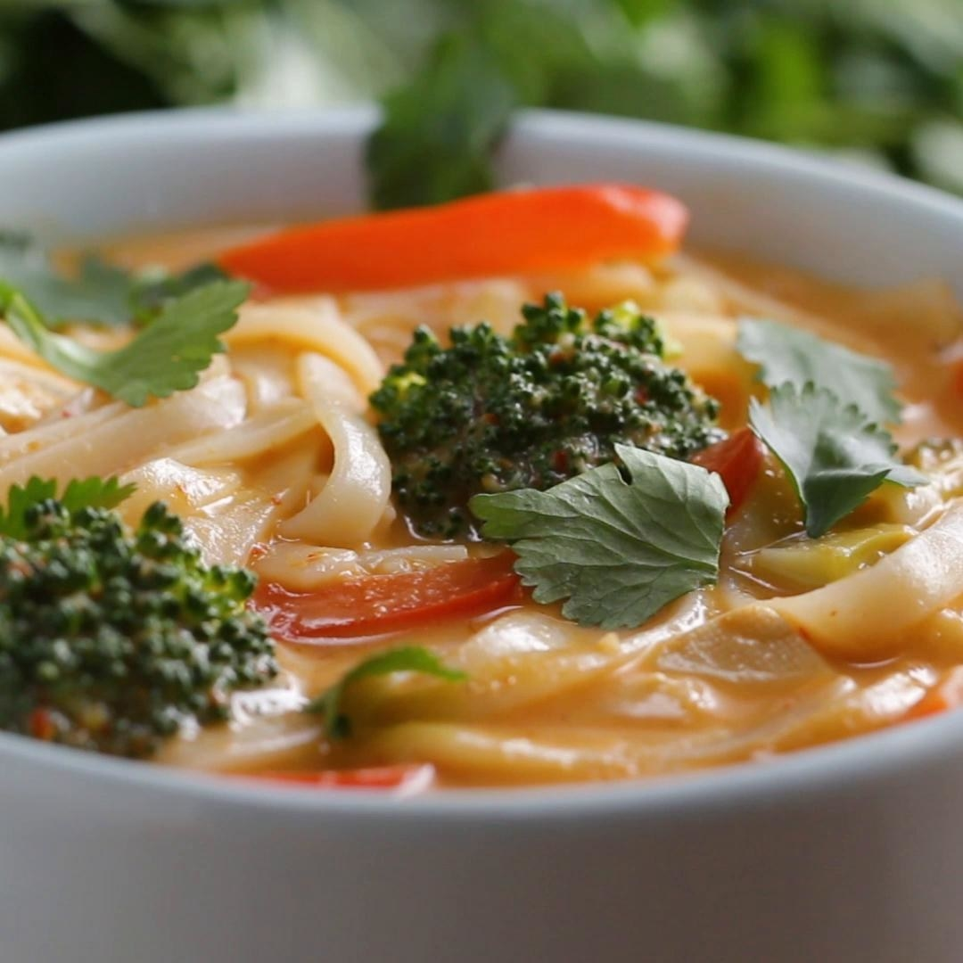 Bowl of curry noodle soup with veggies