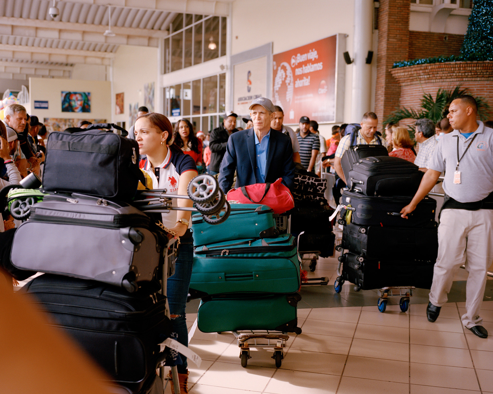 The photographer's father with a large baggage cart in an airport