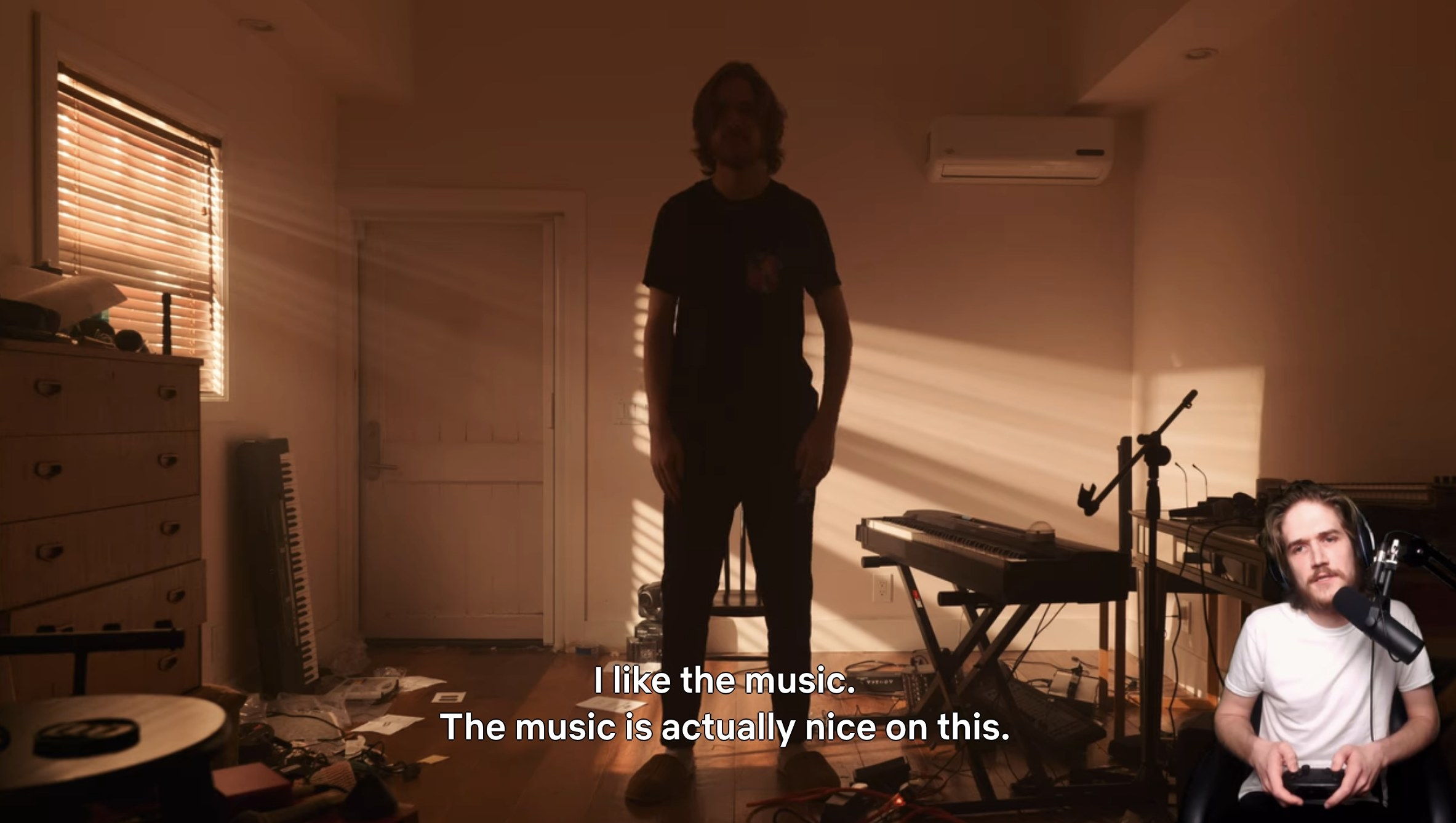"""Bo Burnham plays video game where he is the main character with the caption: """"I like the music. The music is actually nice on this"""""""