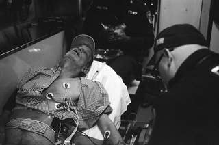 The photographer's father looking unconscious in an ambulance