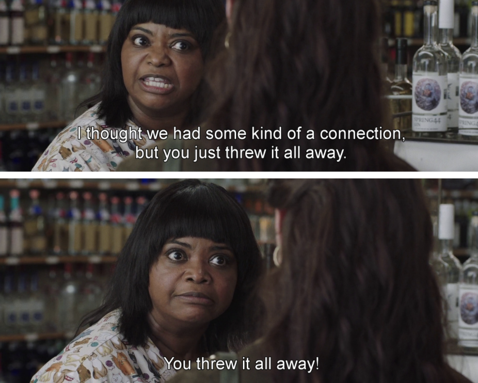 Sue Ann talking to someone at the liquor store