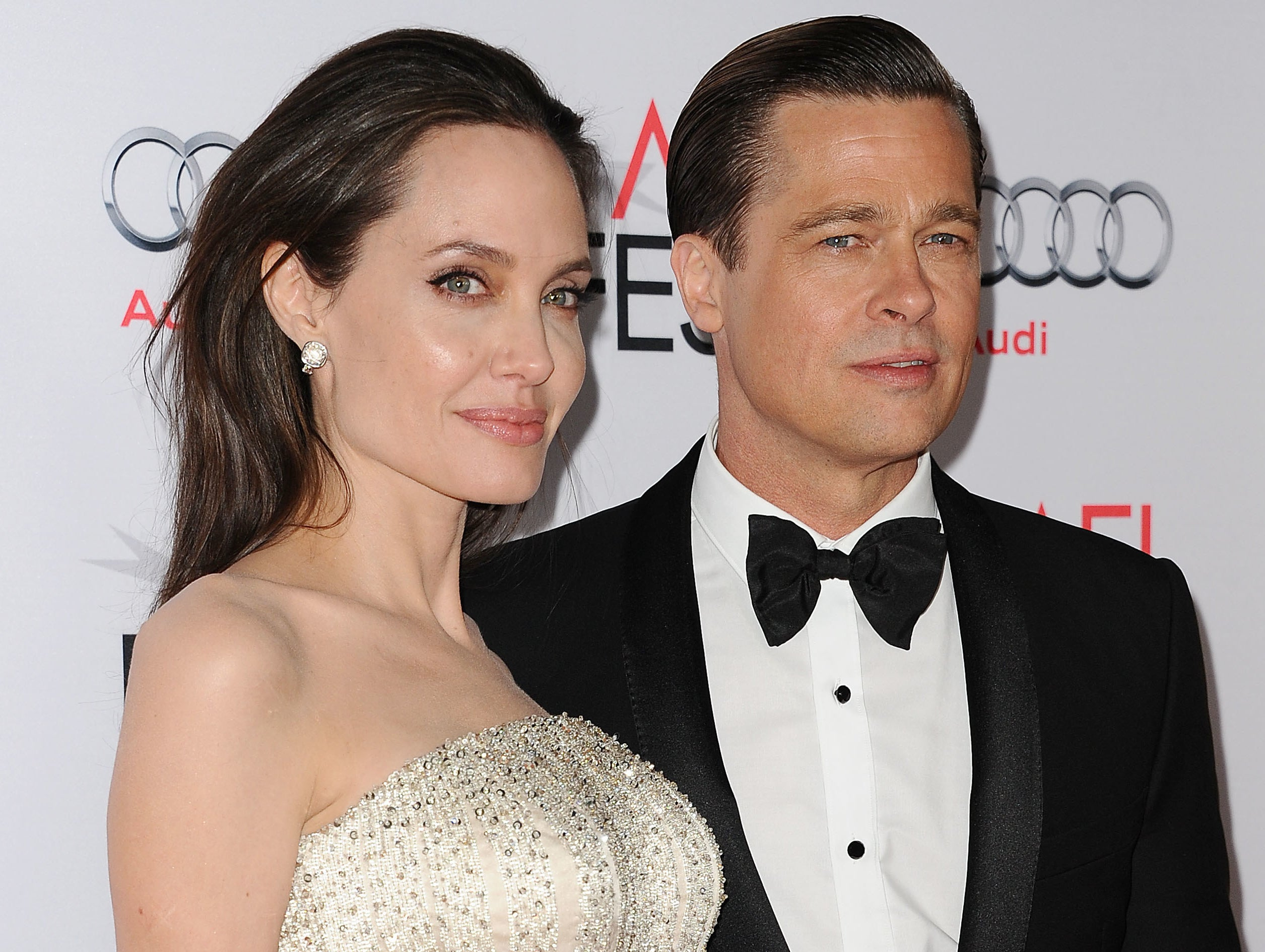 Angelina poses with Brad at an old event