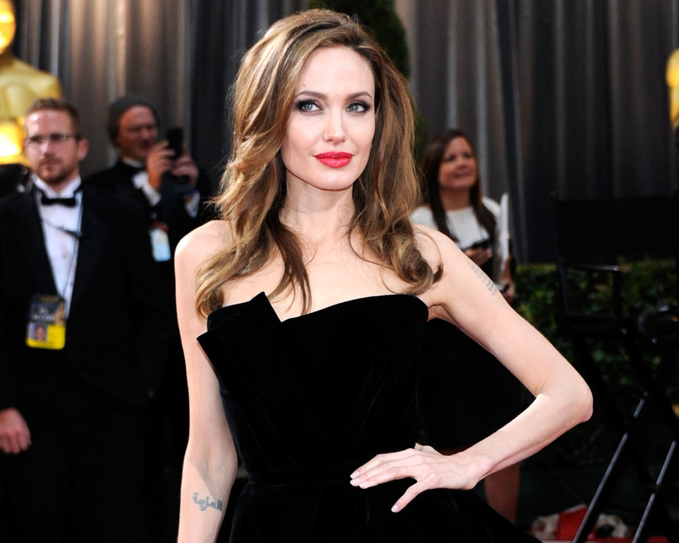 Angelina wears a strapless black dress to an event