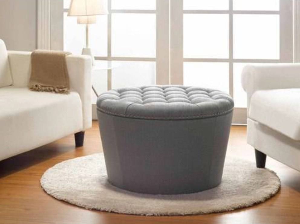 the tufted storage ottoman in gray