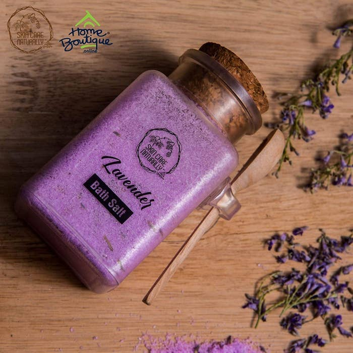 Lavender bath salts in a glass bottle with a cork.