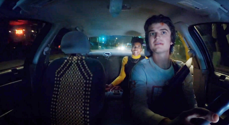 Joe Keery drives Sasheer Zamata in his car