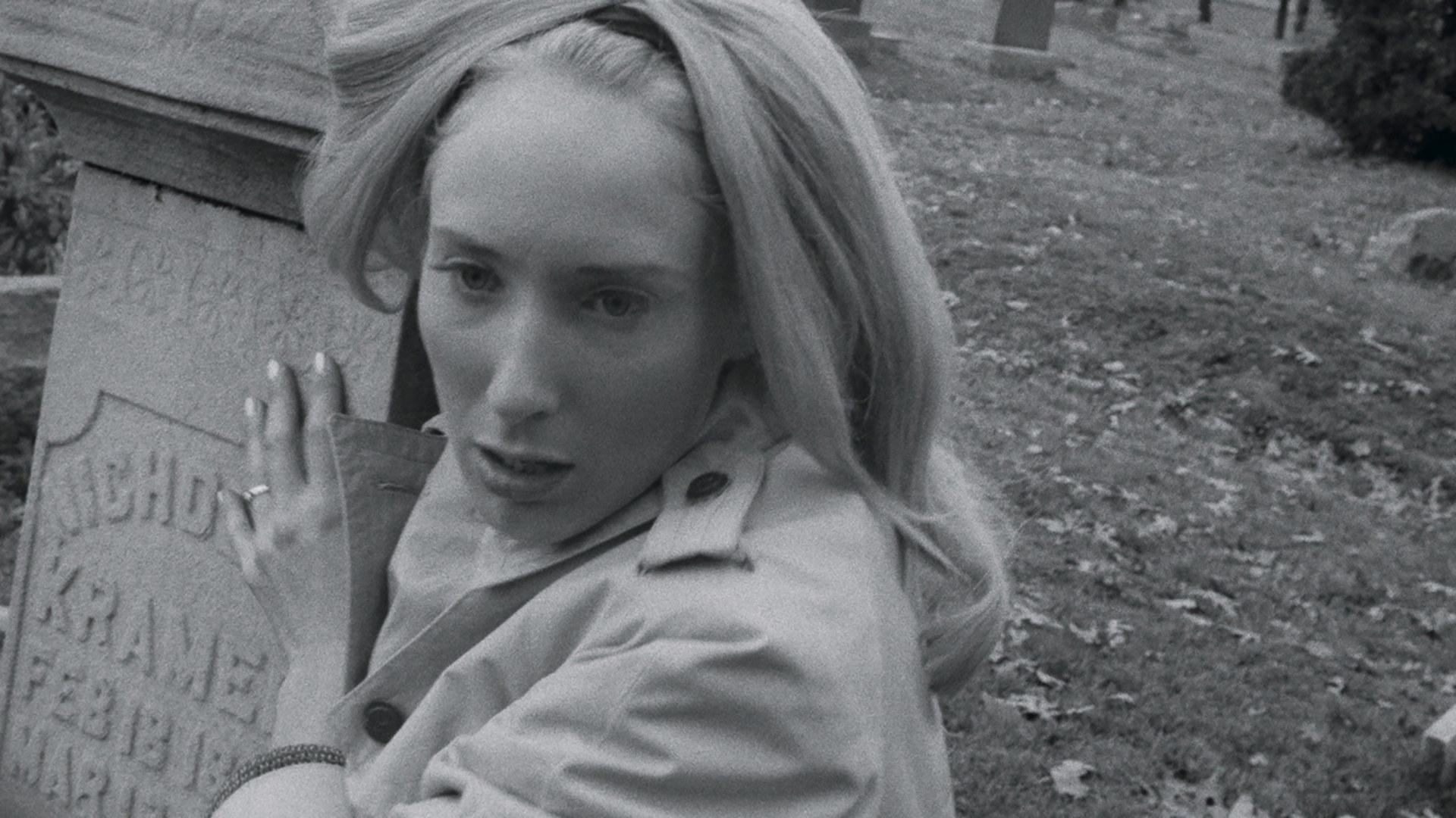 Judith O'Dea clutches a tombstone