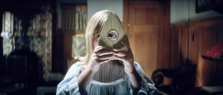 Lulu Wilson looks through a Ouija piece