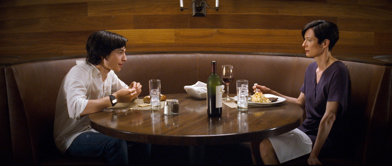 Ezra Miller sits across the table from Tilda Swinton