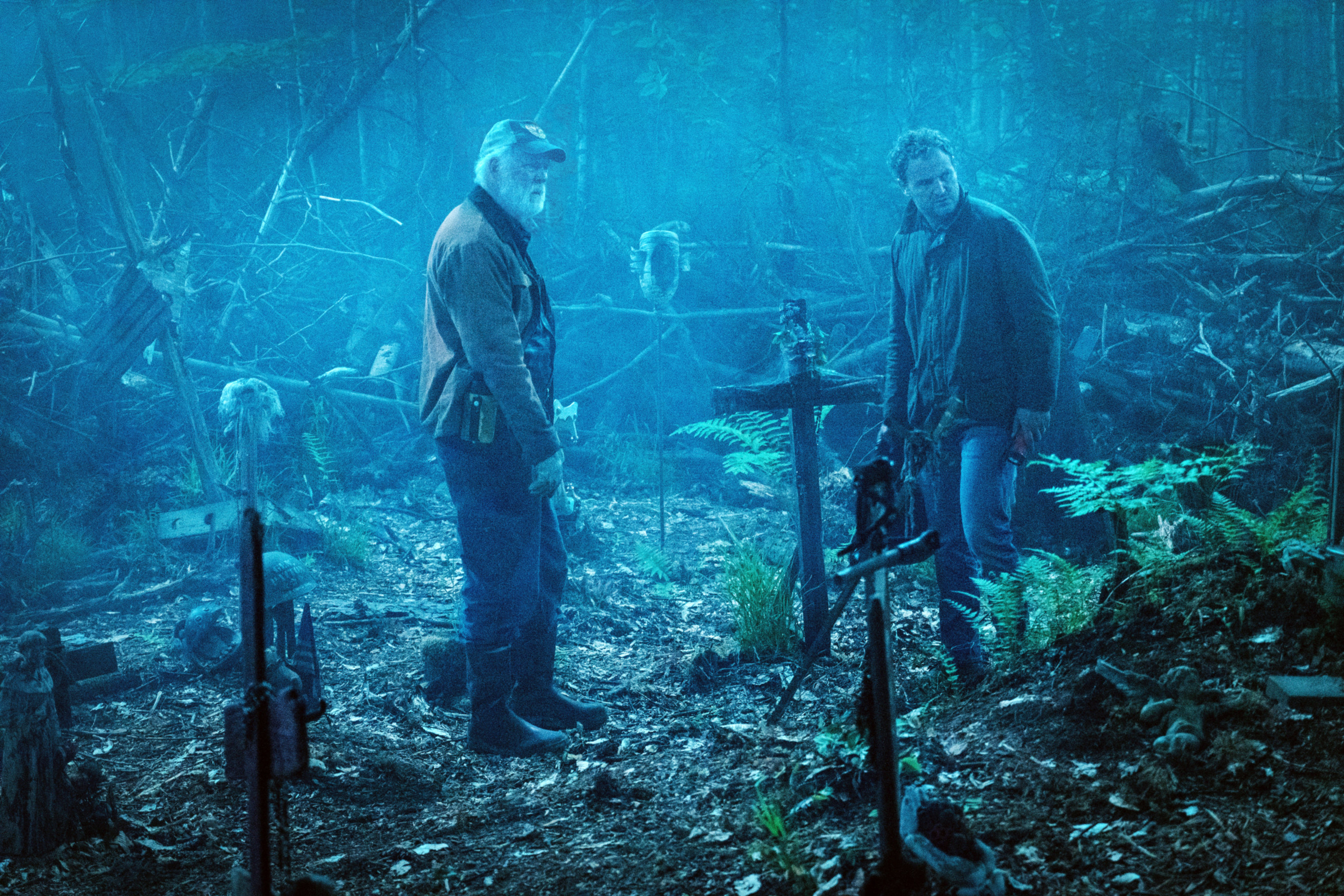 John Lithgow and Jason Clarke in a pet cemetery