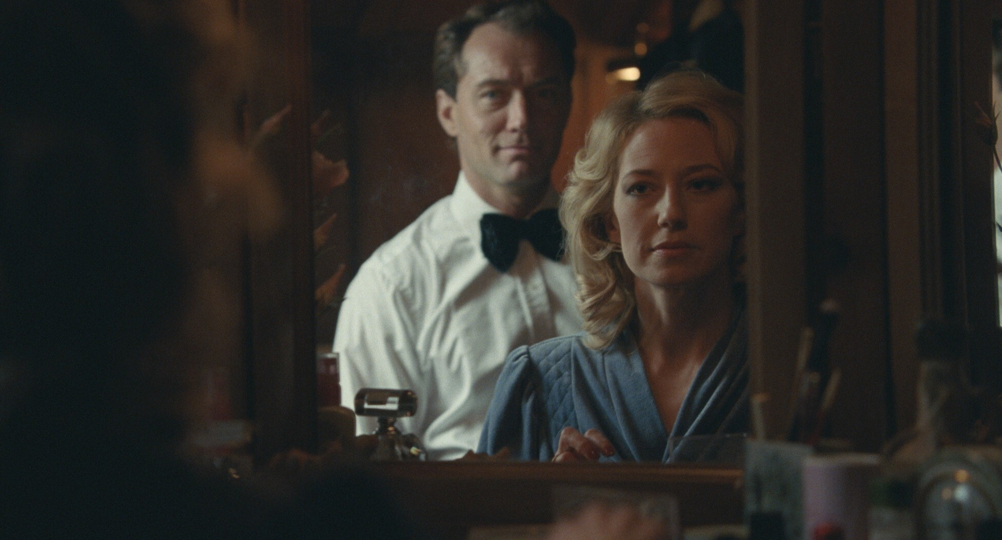Jude Law and Carrie Coon look into a mirror