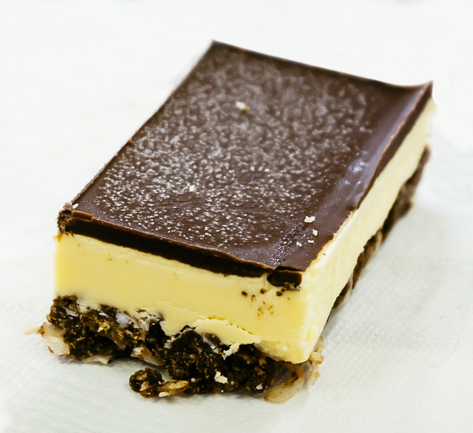 The Nanaimo bar is placed simply against a white backdrop