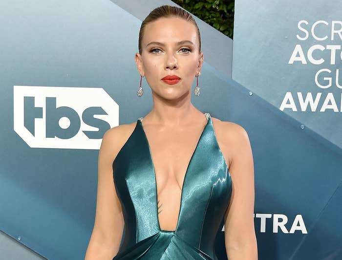 Scarlett wears a turquoise dress with a plunging neckline to an event
