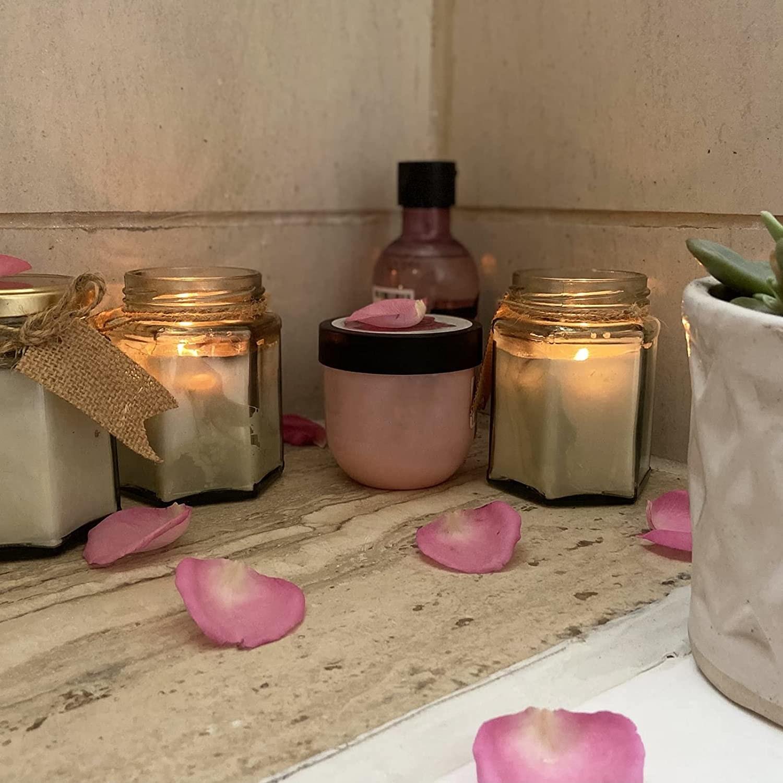 Candles in hexagonal jars