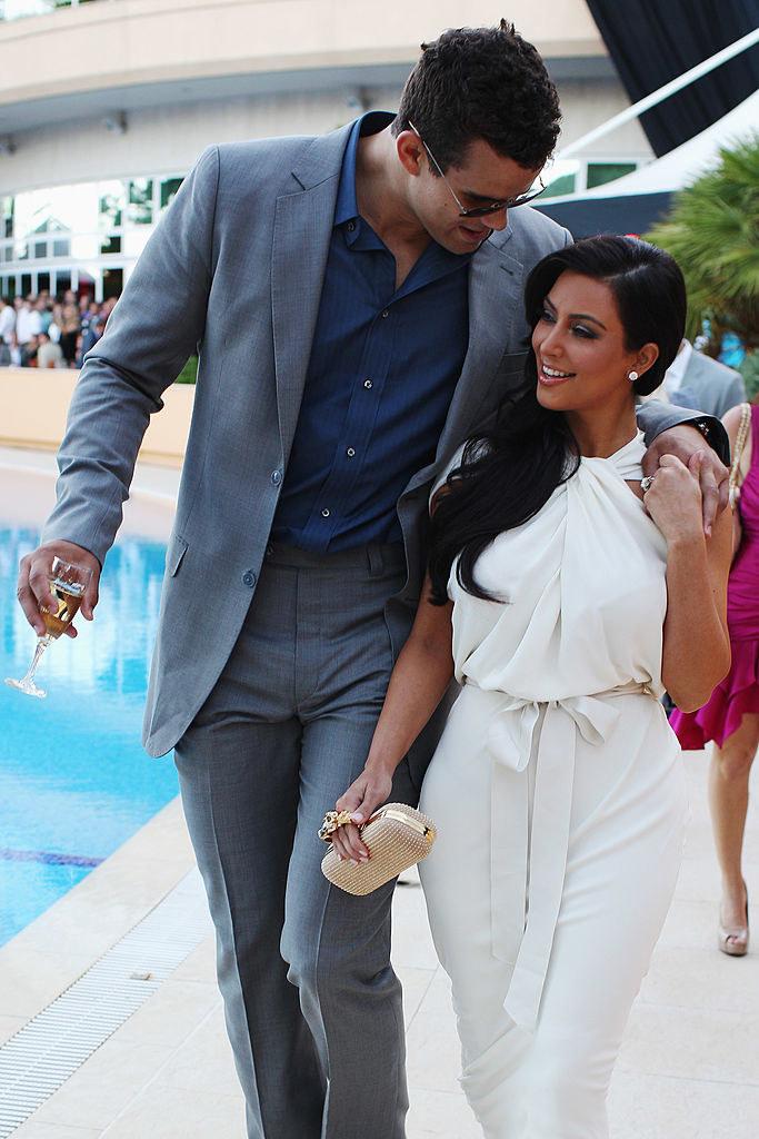 Kim Kardashian (R) and Kris Humphries attend the Amber Fashion Show