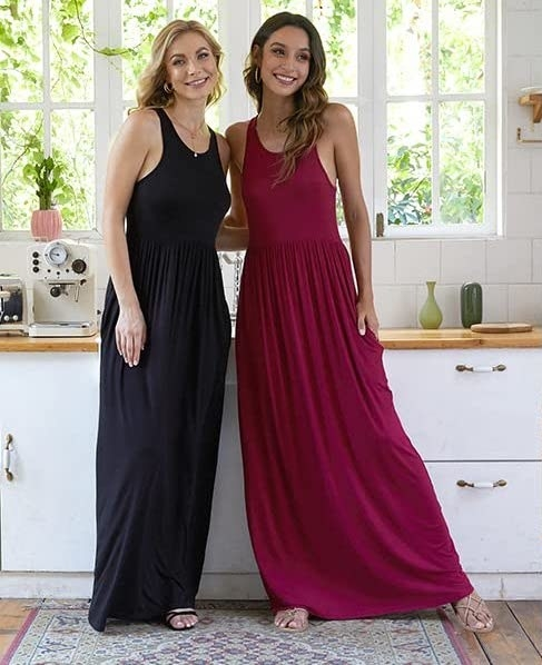Two people wearing the dresses in a kitchen