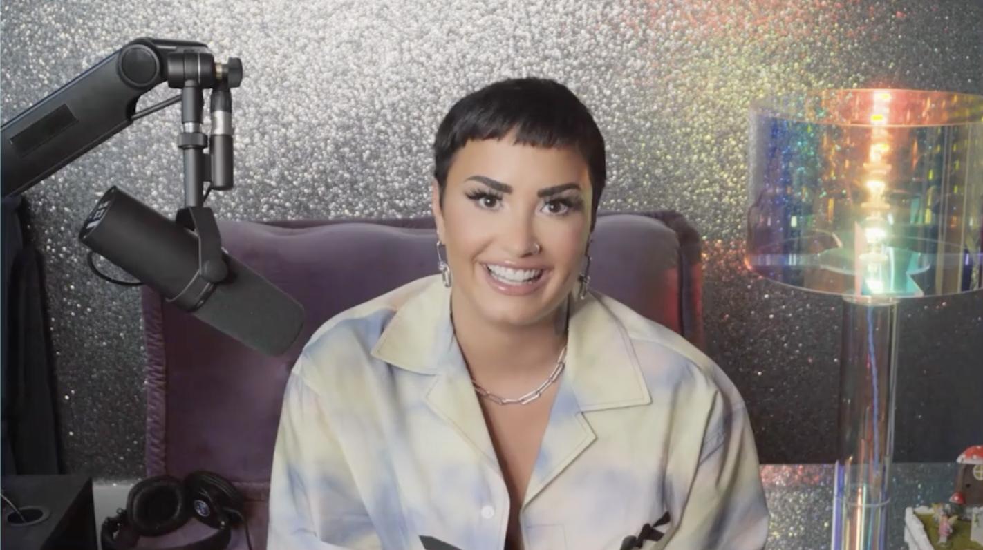Demi smiling into the camera