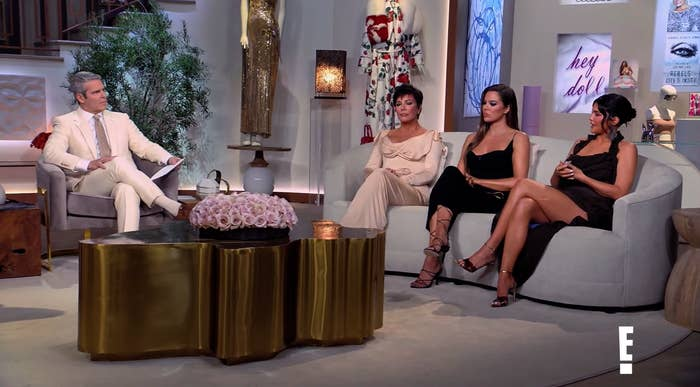 Andy Cohen, Kris Jenner, Khloe Kardashian, and Kylie Jenner sit on couches